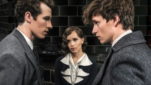 Callum Turner, from left, Zoe Kravitz and Eddie Redmayne in 'Fantastic Beasts: The Crimes of Grindelwald.' (Jaap Buitendijk / Warner Bros. Pictures via AP)