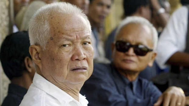 Khieu Samphan, left, and Nuon Chea, right, attend the funeral for the former wife of Pol Pot, in Pailin, northwestern Cambodia, on July 3, 2003. (Andy Eames / AP)