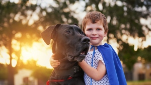 New research has revealed that certain dog characteristics may affect a child's risk of asthma. (PeopleImages / IStock.com)