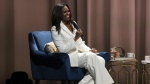 """Former first lady Michelle Obama speaks at the """"Becoming: An Intimate Conversation with Michelle Obama"""" event at the Forum on Thursday, Nov. 15, 2018, in Inglewood, Calif. (Photo by Willy Sanjuan/Invision/AP)"""