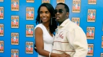 This Feb. 15, 2004, file photo shows Sean P. Diddy Combs and his then girlfriend Kim Porter arriving at Staples Center for the NBA All-Star game in Los Angeles. (AP Photo/Nam Y. Huh, File)