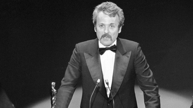 """In this March 28, 1977 file photo, William Goldman accepts his Oscar at Academy Awards in Los Angeles, for screenplay from other medium for """"All The President's Men."""" (AP Photo, File)"""