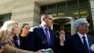 CNN's Jim Acosta, center, listens as lawyer Ted Boutrous, right, speaks to the media as they leave the U.S. District Courthouse, Friday, Nov. 16, 2018, in Washington. U.S.  (AP Photo/Jose Luis Magana)