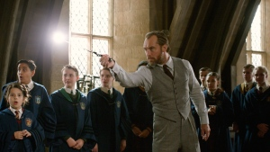 This image released by Warner Bros. Pictures shows Jude Law in a scene from 'Fantastic Beasts: The Crimes of Grindelwald.' The British actor says he spent an afternoon jotting down notes from author J.K. Rowling who talked to him about Dumbledore's life before becoming the world's most powerful wizard and a fan-favorite in the 'Harry Potter' series. He will portray the beloved character in 'Fantastic Beasts: The Crimes of Grindelwald' which arrives in theaters on Friday. (Warner Bros. Pictures via AP)