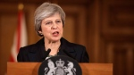 Britain's Prime Minister Theresa May speaks during a press conference inside 10 Downing Street in London, Thursday, Nov. 15, 2018. (AP Photo/Matt Dunham, Pool)