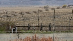 South Korean army soldiers patrol along the barbed-wire fence in Paju, South Korea, near the border with North Korea, Friday, Nov. 16, 2018. (AP Photo/Ahn Young-joon)