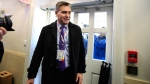 CNN's Jim Acosta enters the Brady press briefing room upon returning back to the White House in Washington, Friday, Nov. 16, 2018. (AP Photo/Manuel Balce Ceneta)