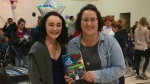 Survivor 101 student Rebecca Storey, left, with organizer Dawn Kellington. (Blair Farthing/CTV Saskatoon)
