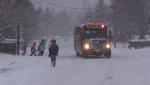 A Dufferin County school bus stops to pick up a group of children on Friday, November 16, 2018 (CTV News/Roger Klein)