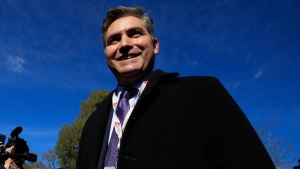 CNN's Jim Acosta speaks to journalist on the North Lawn upon returning back to the White House in Washington, Friday, Nov. 16, 2018. Judge asked the White House to immediately return press credentials of Jim Acosta. (AP / Manuel Balce Ceneta)