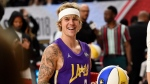 Singer Justin Bieber warms up prior to the NBA All-Star celebrity basketball game Friday, Feb. 16, 2018, in Los Angeles. (AP Photo/Chris Pizzello)