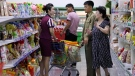 In this Sept. 12, 2018, file photo, North Korean customers get assistance at a supermarket in Pyongyang, North Korea. (AP Photo/Kin Cheung, File)