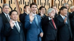 Canadian Prime Minister Justin Trudeau (second from left) and other leaders participate in an APEC Leaders Official Photograph in Port Moresby, Papa New Guinea Saturday November 17, 2018. THE CANADIAN PRESS/Adrian Wyld