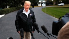 President Donald Trump answers questions from members of the media as he leaves the White House, Saturday Nov. 17, 2018, in Washington, en route to see fire damage in California. (AP Photo/Jacquelyn Martin)