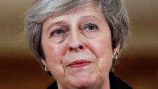 Britain's Prime Minister Theresa May answers a journalist's question during a press conference inside 10 Downing Street in London, Thursday, Nov. 15, 2018. (AP Photo/Matt Dunham, Pool)