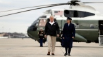 U.S. President Donald Trump walks from Marine One helicopter to board Air Force One for a trip to visit areas impacted by the California wildfires, Saturday, Nov. 17, 2018, at Andrews Air Force Base, Md. (AP Photo/Evan Vucci)
