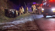 Firefighters rescue a man in the SUV after it crashed on Barnet Hwy.