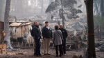 Gov.-elect Gavin Newsom, FEMA Director Brock Long, U.S. President Donald Trump, Paradise mayor Jody Jones and Gov. Jerry Brown tour the Skyway Villa Mobile Home and RV Park, during Trump's visit of the Camp Fire in Paradise, Calif. on Saturday, Nov. 17, 2018, in Chico, Calif. (Paul Kitagaki Jr./The Sacramento Bee via AP, Pool)