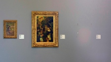 "In this Tuesday, Oct. 16, 2012 file photo, the empty space where Henri Matisse' painting ""La Liseuse en Blanc et Jaune"" was hanging, right, is seen next to a painting by Maurice Denis, center, and Pierre Bonnard, left, at Kunsthal museum in Rotterdam, Netherlands. (AP Photo/Peter Dejong, File)"