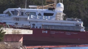 The CCGS Corporal McLaren was discovered on its side in the water Saturday morning after being released from its secured cradle and sliding down a slip at the Canadian Maritime Engineering shipyard in Sambro Head, N.S.