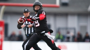 Calgary Stampeders quarterback Bo Levi Mitchell prepares to throw the ball during first-half CFL West Division final football game action against the Winnipeg Blue Bombers in Calgary, Alberta, Sunday, Nov. 18, 2018. (Jeff McIntosh/The Canadian Press via AP)