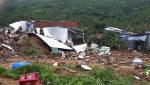 This Sunday, Nov. 18, 2018, photo, shows several houses damaged by landslides in south-central resort city of Nha Trang, Vietnam. A disaster official said the landslides from heavy rains triggered by Tropical Storm Toraji collapsed several houses and buried victims in some villages in the resort city. (Phan Thi Sau/Vietnam News Agency via AP)