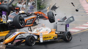 In this Sunday, Nov. 18, 2018, picture, teenage driver Sophia Floersch of Germany, top, goes over Japanese driver Sho Tsuboi's car while flying off the track at high speed on a tight right-hand bend on lap four. (Tony Wong/Apple Daily via AP)