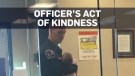 Officer cares for baby while mom files report