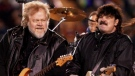 Randy Bachman (left) and Burton Cummings of The Guess Who perform during the halftime show at the 88th Grey Cup game in Calgary, Sunday, Nov.26, 2000. A Winnipeg apartment block that appears to have provided the backdrop for an iconic album cover by the rock group The Guess Who has been heavily damaged by a fire. (THE CANADIAN PRESS / Aaron Harris)