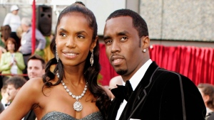In a Feb. 27, 2005 file photo, Sean 'P. Diddy' Combs arrives with date, Kim Porter, for the 77th Academy Awards in Los Angeles. (AP / Amy Sancetta, File)