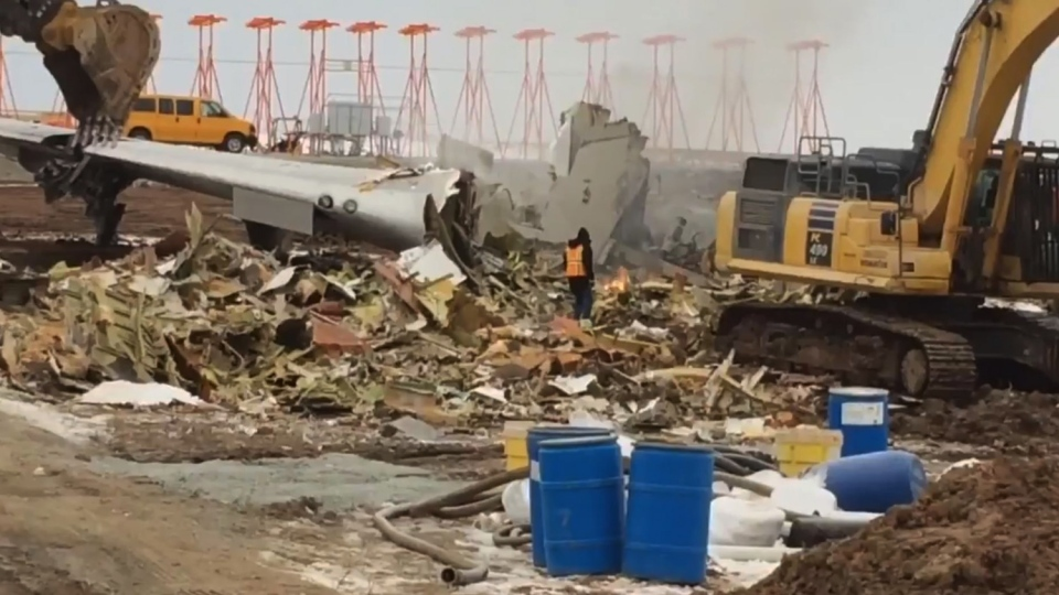 A cargo plane is dismantled at the Halifax Stanfield International Airport on Nov. 19, 2018, almost two weeks after it skidded off the runway.