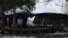 A house fire in Oro-Medonte still smolders a day after firefighters put out flames that ripped through it completely destroying the structure, Monday, Nov. 19, 2018 (CTV News/Beatrice Vaisman)