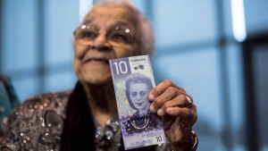 Wanda Robson, sister of Viola Desmond, holds the new $10 bank note featuring Desmond during a press conference in Halifax on Thursday, March 8, 2018. A new $10 banknote featuring Viola Desmond's portrait will go into circulation in a week, just over 72 years after she was ousted from the whites-only section of a movie theatre in New Glasgow, N.S. (THE CANADIAN PRESS / Darren Calabrese)