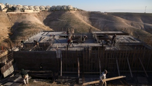 In this Feb. 7, 2017 file photo, Palestinian laborers work at a construction site in the Israeli settlement of Maale Adumim, near Jerusalem. (AP Photo/Oded Balilty)