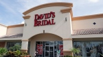 The entrance to a David's Bridal store is seen Monday, Nov. 19, 2018, in Orlando, Fla. (AP Photo/John Raoux)