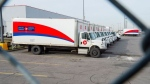 Idle Canada Post trucks sit in the parking lot of the Saint-Laurent sorting facility in Montreal as rotating strikes hit the area on Thursday November 15, 2018. (THE CANADIAN PRESS/Ryan Remiorz)