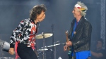 FILE - In this May 25, 2018 file photo, Mick Jagger, left, and Keith Richards, of The Rolling Stones, perform during their No Filter tour in London. (Photo by Mark Allan/Invision/AP, File)
