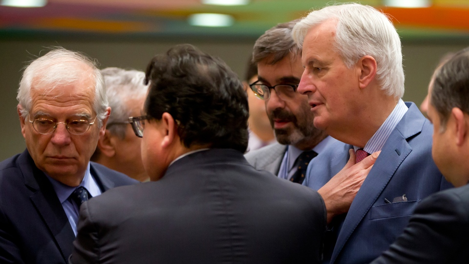 EU chief Brexit negotiator Michel Barnier, right, speaks with Spain's Minister of Foreign Affairs Josep Borrell, left, during a meeting of EU General Affairs ministers, Article 50, at the Europa building in Brussels on Monday, Nov. 19, 2018. (AP / Virginia Mayo)