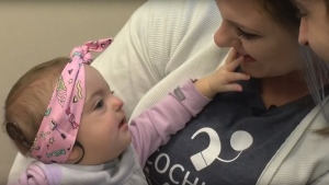 A 7-month-old baby in the U.S. with a rare genetic disorder that causes deafness recently heard her parents' voices for the first time after a surgical team at the Mayo Clinic placed cochlear implants in her head. (Mayo Clinic News Network)