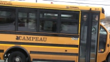 Police stop distracted drivers, from a school bus
