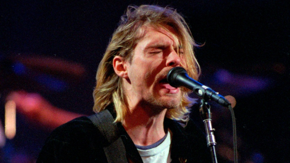 This Dec. 13, 1993 file photo shows Kurt Cobain of the band Nirvana performing in Seattle. (AP Photo/Robert Sorbo)