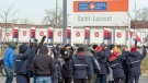 Striking Canada Post workers walk the picket line in front of the Saint-Laurent sorting facility in Montreal on Thursday November 15, 2018. THE CANADIAN PRESS/Ryan Remiorz