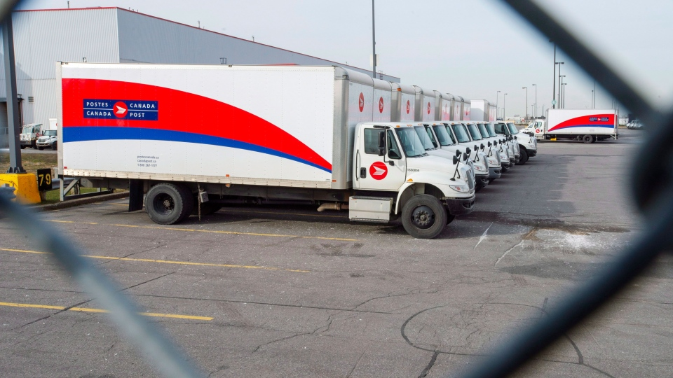 Idle Canada Post trucks sit in the parking lot of the Saint-Laurent sorting facility in Montreal as rotating strikes hit the area on Thursday November 15, 2018. THE CANADIAN PRESS/Ryan Remiorz