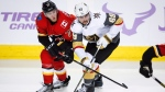 Vegas Golden Knights' Alex Tuch, right, and Calgary Flames' Mark Jankowski batte for position during third period NHL hockey action in Calgary, Monday, Nov. 19, 2018.THE CANADIAN PRESS/Jeff McIntosh