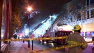 Firefighters put out a quickly-spreading fire in a commercial/residential building on Wellington St. at Hickson St. on Nov. 20, 2018 (CTV Montreal/Cosmo Santamaria)