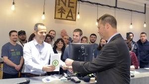 NETA co-founder Arnon Vered sells Northampton Mayor David Narkewicz the first legal recreational sale of marijuana at the NETA facility on Tuesday, Nov. 20, 2018, in Northampton, Mass. The state's first commercial pot shops opened Tuesday in Leicester and Northampton. (Don Treeger / The Republican via AP)