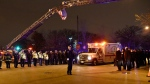 Chicago police officers and firefighters form an honor guard as the body of Chicago Police Officer Samuel Jimenez is brought to the coroner Monday, Nov. 19, 2018, in Chicago. A gunman opened fire Monday at a Chicago hospital, killing the police officer and a few hospital employees in an attack that began with a domestic dispute and exploded into a firefight with law enforcement inside the medical center. The suspect was also dead, authorities said. (AP / David Banks)