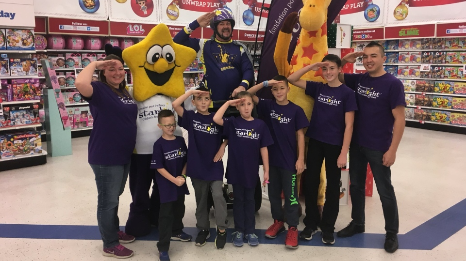 An 11-year-old St. Thomas boy with Ehlers-Danlos Syndrome gets a three-minute shopping spree at the Toys R Us Canada store in Windsor, Ont., on Tuesday, Nov. 20, 2018. (Chris Campbell / CTV Windsor)