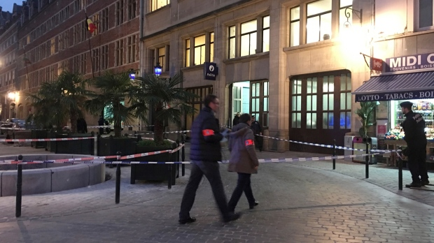 A police officer stands behind a police tape during investigations at a stabbing scene in the center of Brussels, Tuesday, Nov. 20, 2018. (AP Photo/Sylvain Plazy)