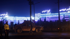 Security forces inspect the site of a suicide attack, happened inside a wedding hall in Kabul, Afghanistan, Nov. 20, 2018. A(AP Photo/Massoud Hossaini)